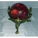 Ornate stand with red globe