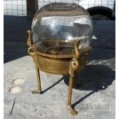 Glass globe on brass stand