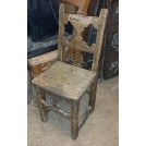 Worn carved wood chair