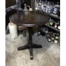 Round dark wood pub table