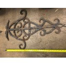 Large iron ornate door hinge
