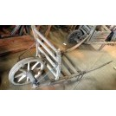 Early slatted wood wheelbarrow