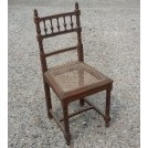 Carved wood chair with woven seat