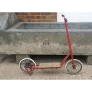 Red metal period scooter
