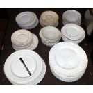 Assorted white china plates