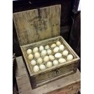 Period wood egg box with eggs