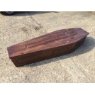 Dark carved wood coffin