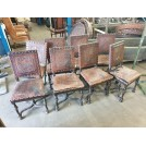 Worn embossed & studded leather chairs