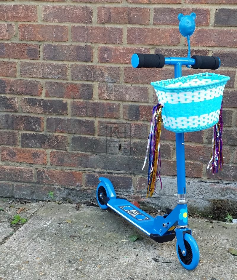 Childs blue scooter with basket