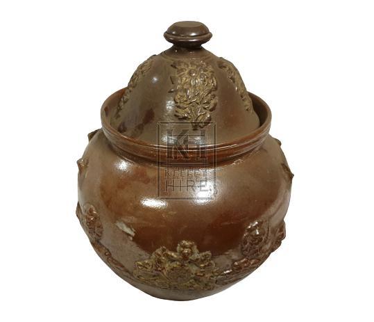 Ornate ceramic pot with lid