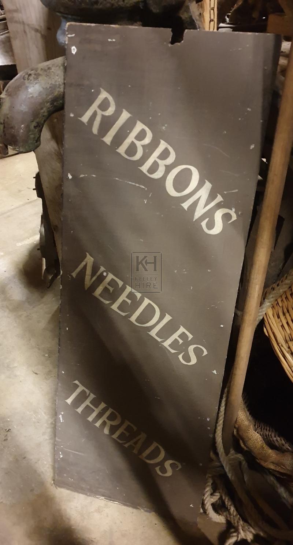 Ribbons & needles sign