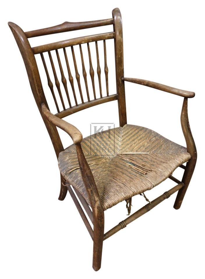 Straw seat shaped chair with arms