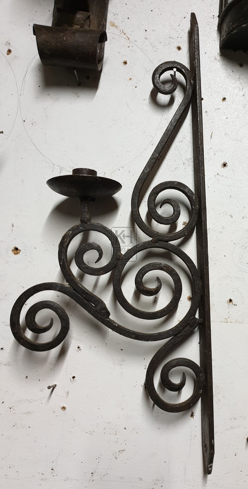 Iron wall scroll candle holder