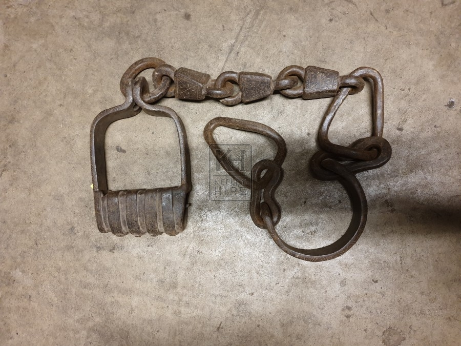 Ornate iron manacle on chain