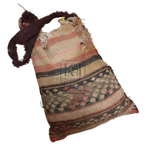 Worn striped canvas bag