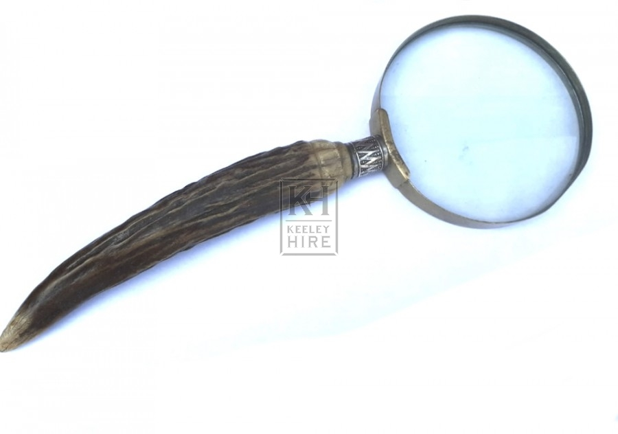 Magnifying glass hand held
