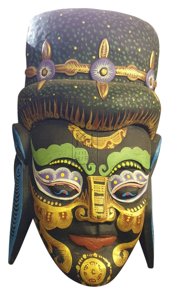 Dark painted carved wood mask