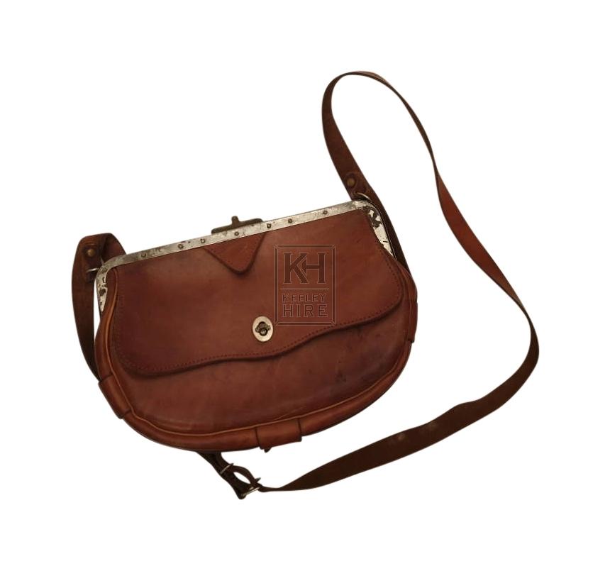 Leather bag with metal edge