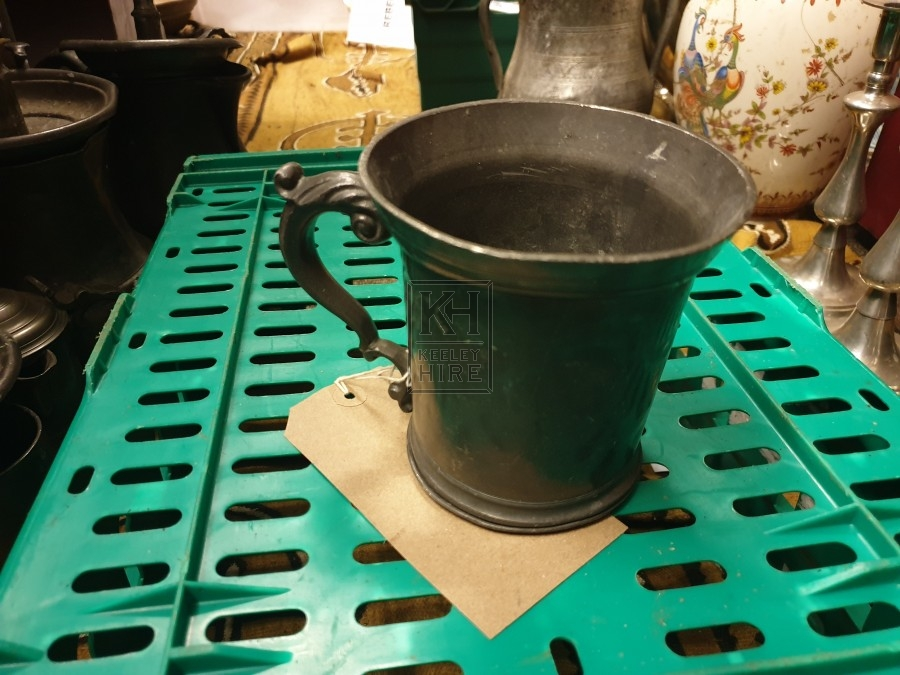 Large pewter tankard with ornate handle