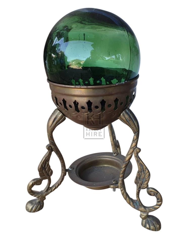 Glass crystal ball on gold base
