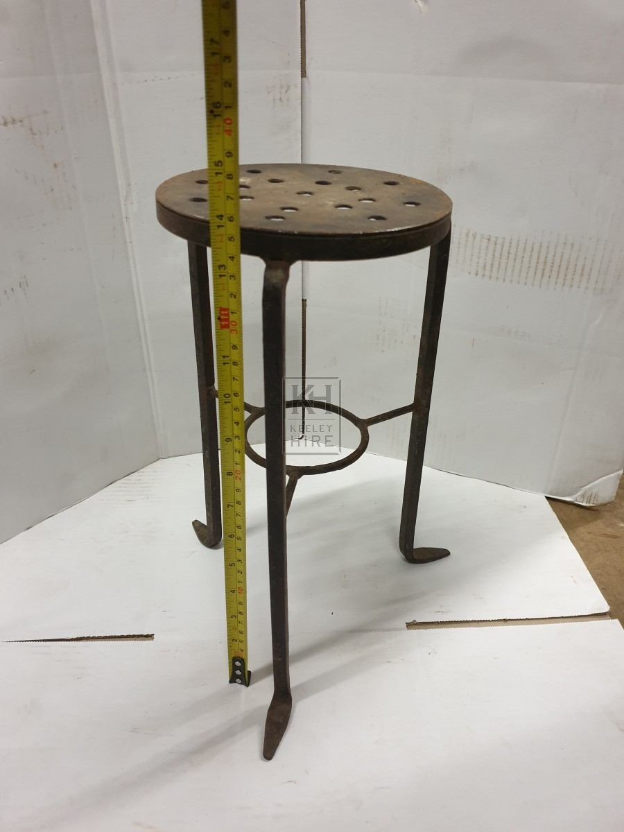 Tall round iron trivet with holes