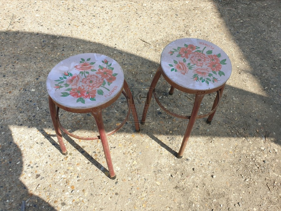 Round metal stool with flowers