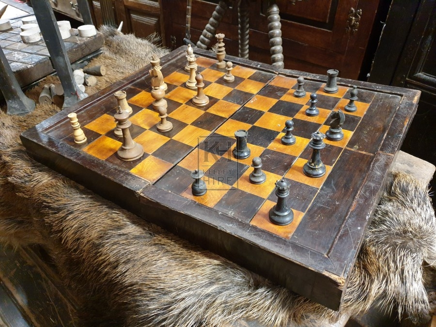 Folding chess board with pieces