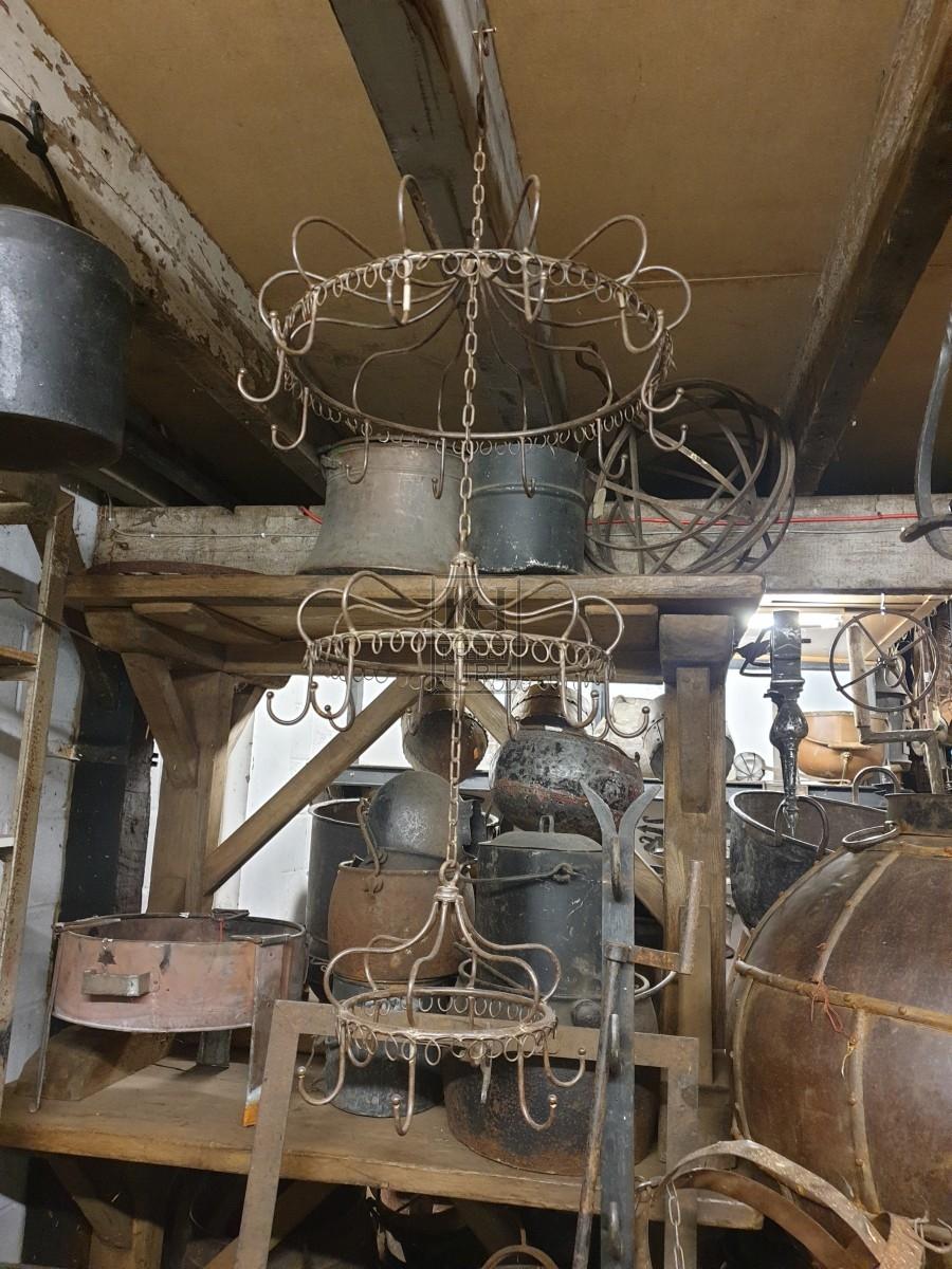 Ornate iron hooks on triple rings