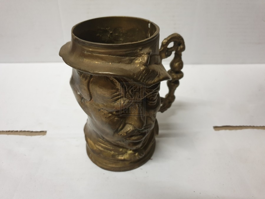 Brass tankard with face
