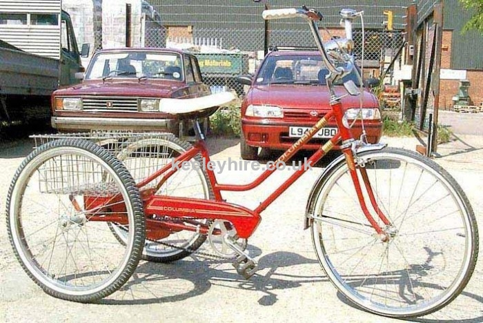 Red tricycle with wire basket