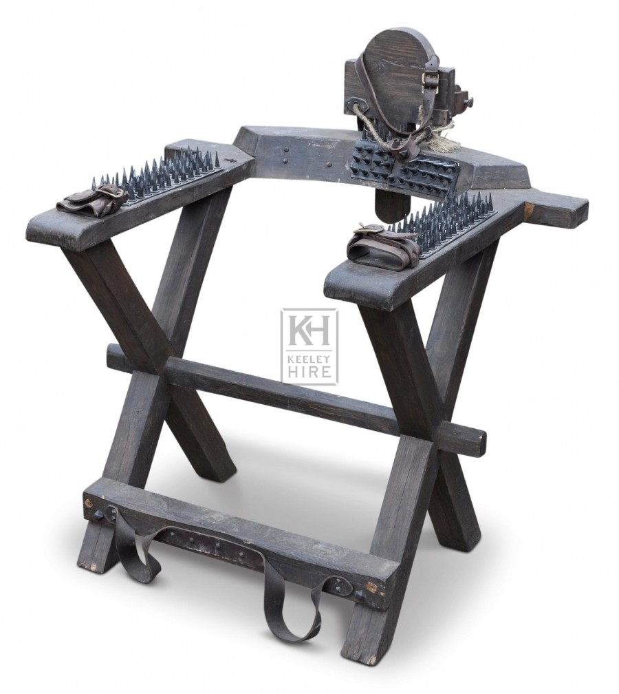 Torture chair with spikes
