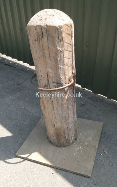 Wood dock post with curved iron bar
