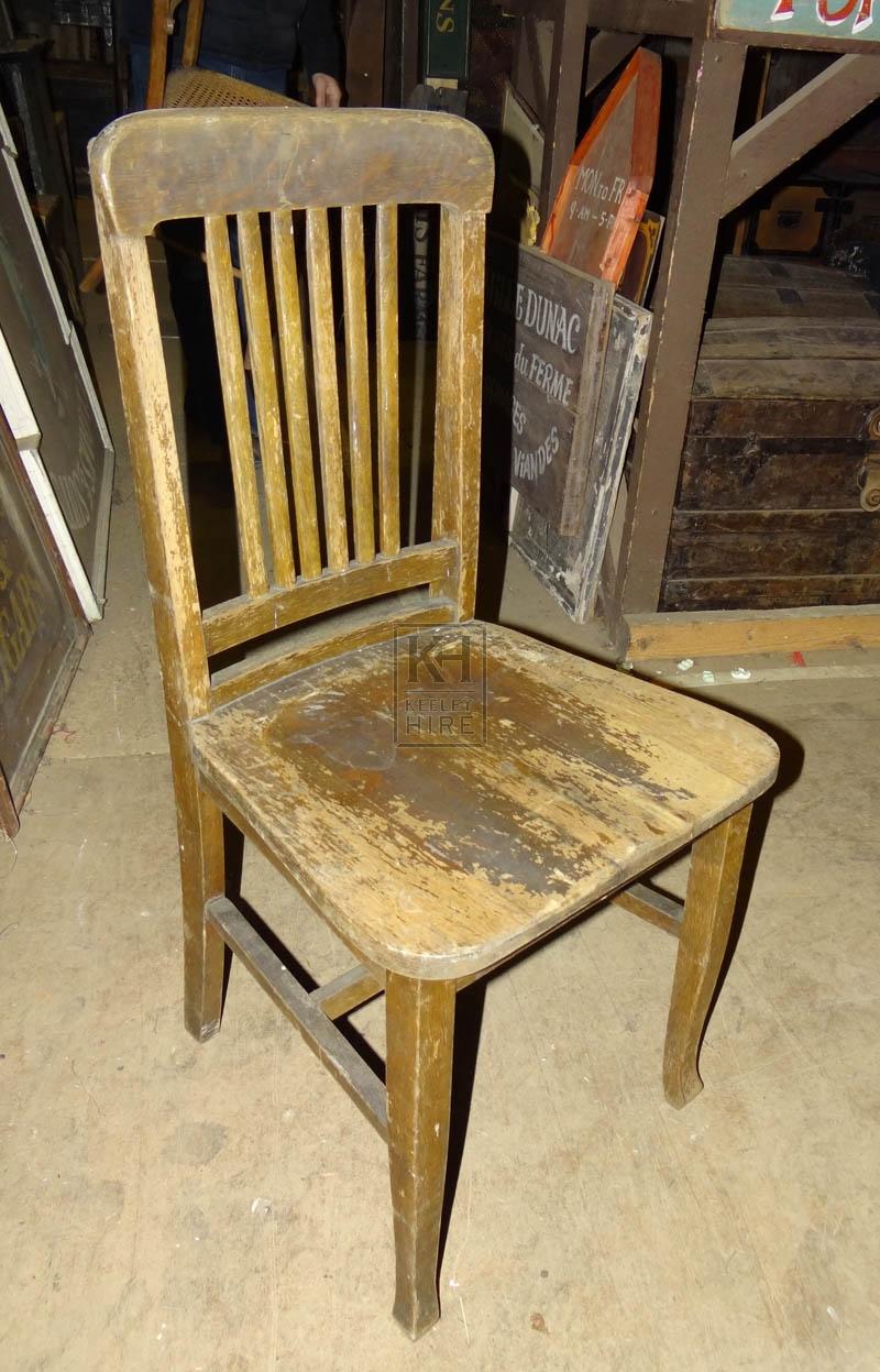 Worn slatted simple wood chair