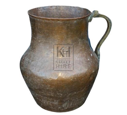 Wide bulbous copper jug
