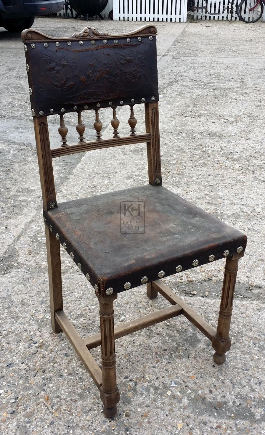 Leather studded chair with turned legs
