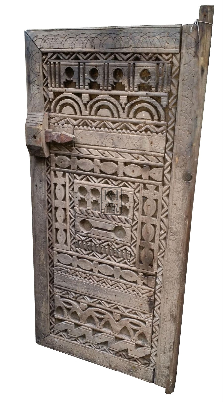Heavily carved wood door