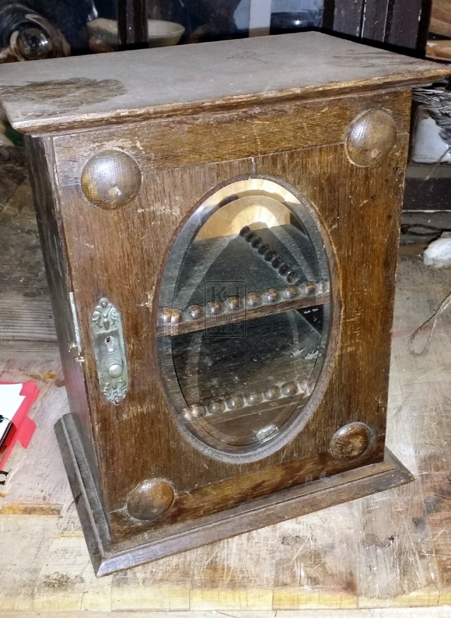 Small wood cabinet with glass oval