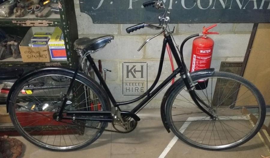Period ladies black bicycles 40s