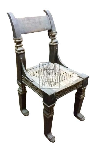 Dark wood chair with gold trim rattan