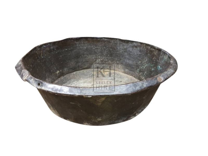 Very large beaten copper bowl
