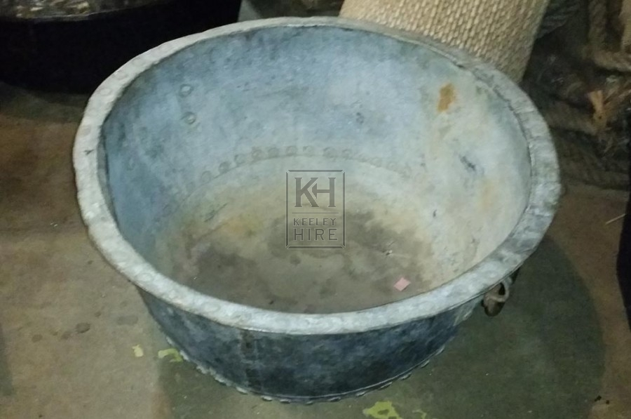 Large metal bowl with rivets