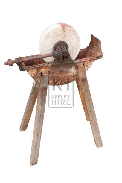 Iron & wood grindstone
