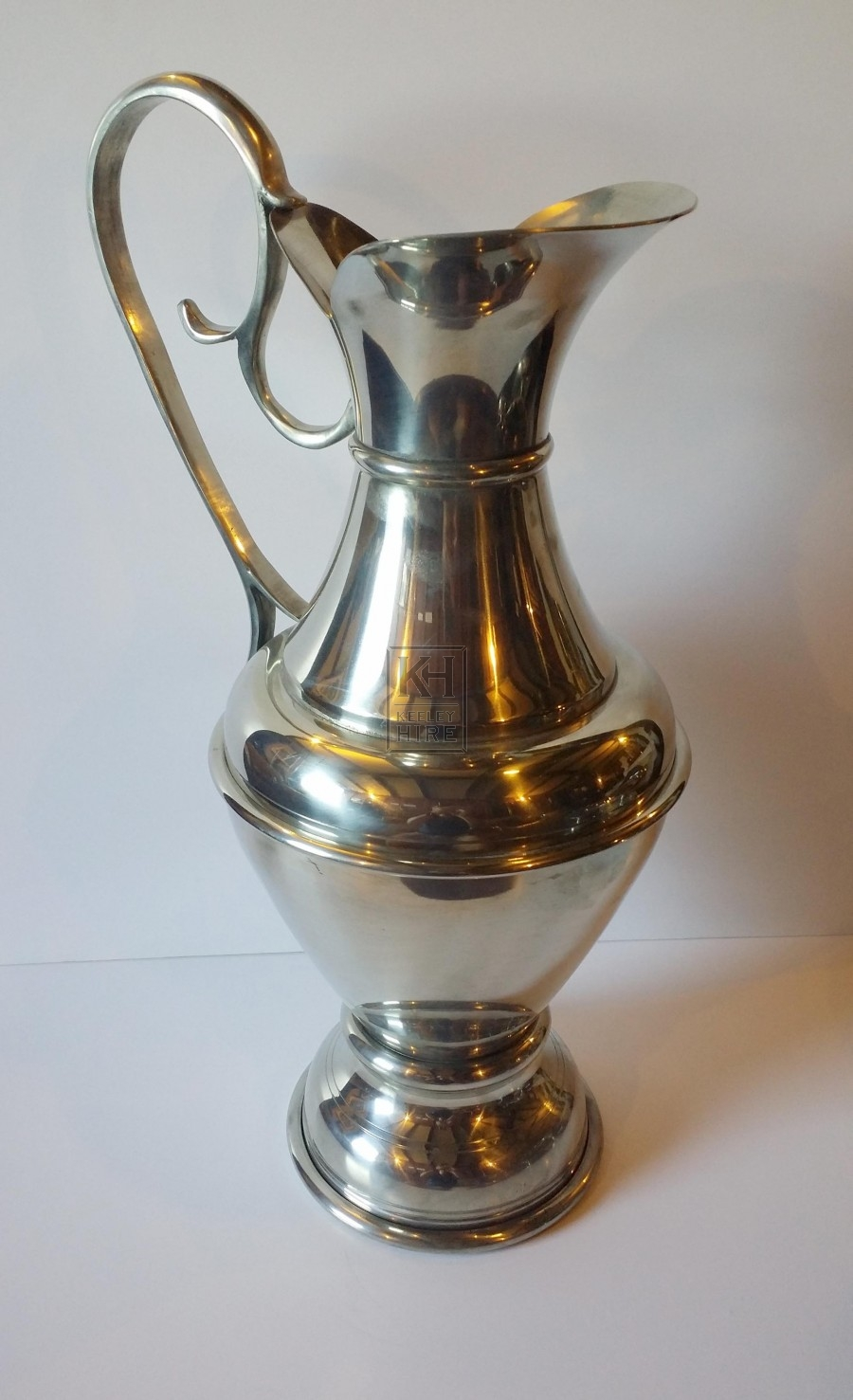 Very large silver jug with handle