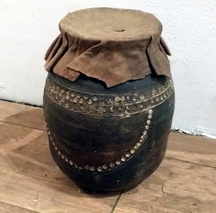 Ornate earthenware jar with leather top