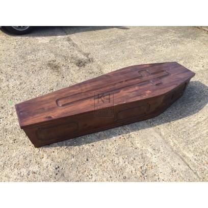 Dark carved wood coffin